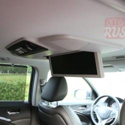 В Acura MDX телевизоров два - на потолке и на передней панели