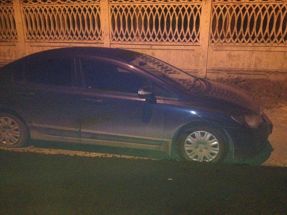 автомобиль закатали в асфальт