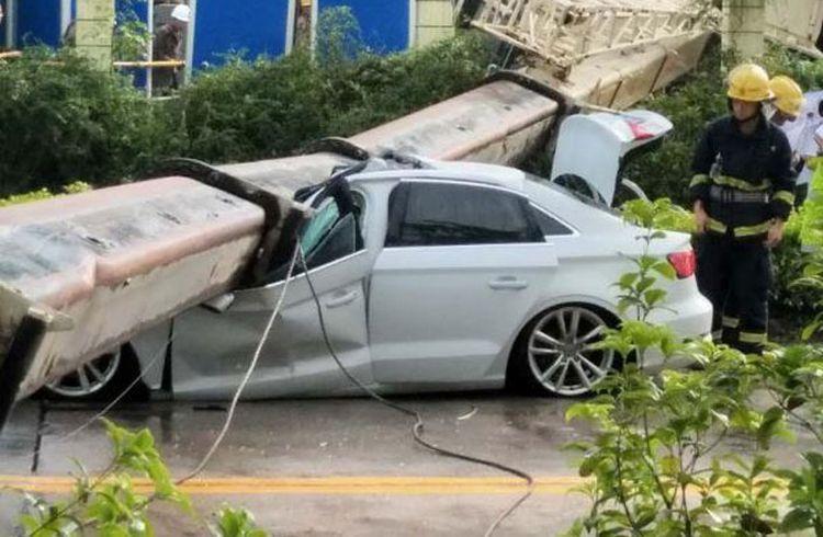 кран раздавил Audi